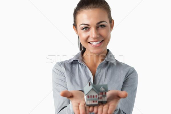 Homme agent immobilier miniature maison mains Photo stock © wavebreak_media