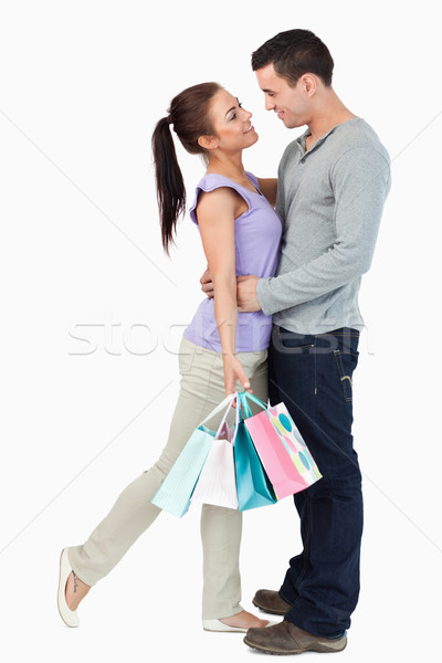 Young couple hugging during shopping tour against a white background Stock photo © wavebreak_media