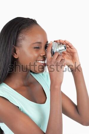 улыбающаяся женщина наушники пения белый счастливым микрофона Сток-фото © wavebreak_media
