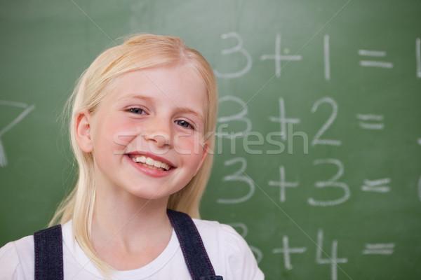 Blond schoolmeisje poseren Blackboard school student Stockfoto © wavebreak_media