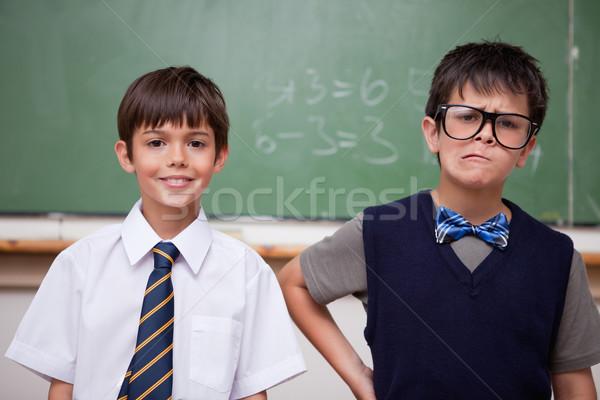 Schoolboys posing in front of a chalkboard in a classroom Stock photo © wavebreak_media