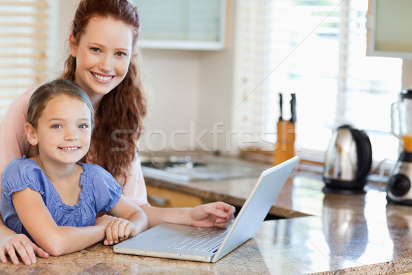 Mother and daughter surfing the internet together in the kitchen Stock photo © wavebreak_media