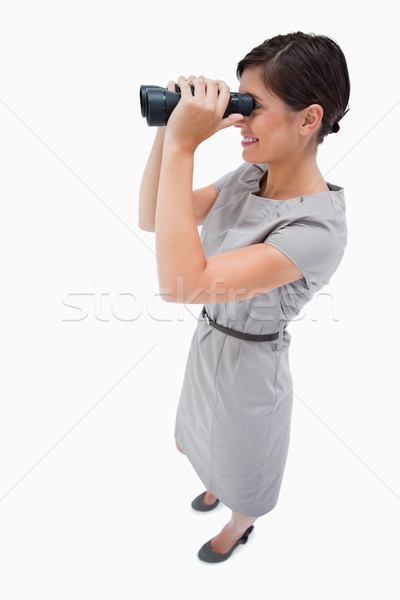 Side view of woman using spyglasses against a white background Stock photo © wavebreak_media