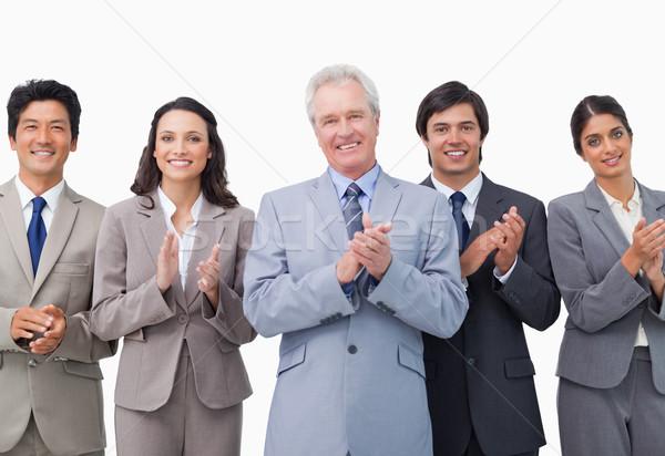 Senior businessman and his team applauding against a white background Stock photo © wavebreak_media