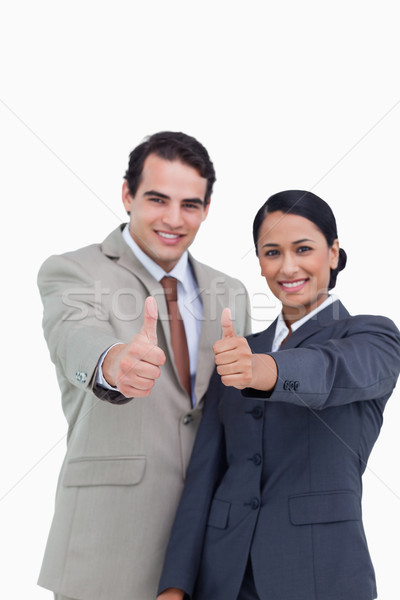 Smiling young salesteam giving their approval against a white background Stock photo © wavebreak_media