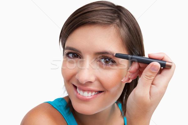 Fiatal vonzó nő szemöldök ceruza smink szem Stock fotó © wavebreak_media