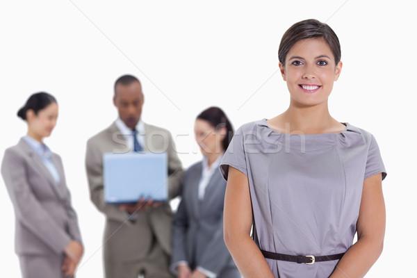 Mujer equipo de negocios viendo portátil blanco empresario Foto stock © wavebreak_media