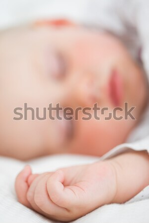 Baby lying on a bed while closing her eyes in a bright room Stock photo © wavebreak_media