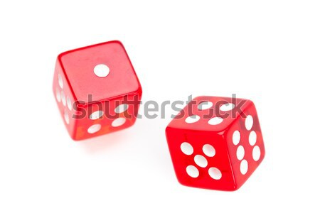 Two red dices moving agaisnt a white background Stock photo © wavebreak_media