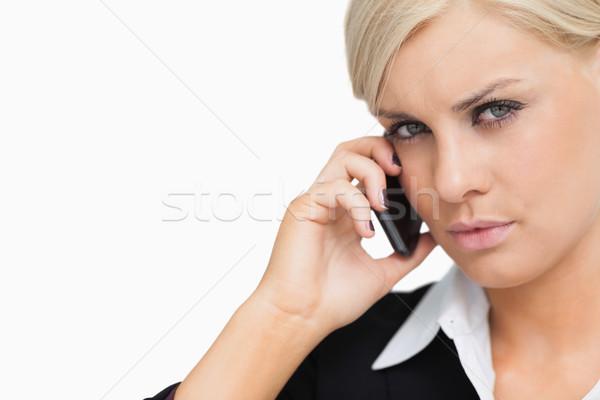 Vonzó üzletasszony mobil fehér telefon öltöny Stock fotó © wavebreak_media