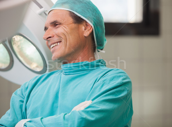 Surgeon smiling with arms crossed in operating theatre in hospital Stock photo © wavebreak_media