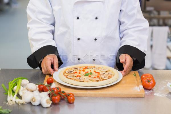 Pizza on the kitchen counter ready to go Stock photo © wavebreak_media