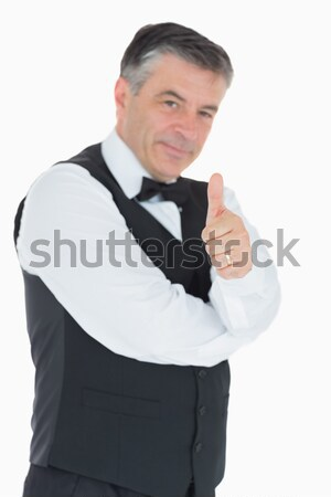 Man in waistcoat giving thumbs up Stock photo © wavebreak_media