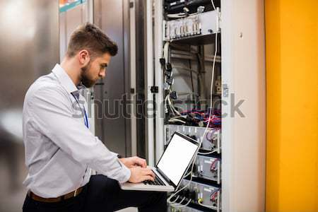 Electrician doing server  maintenance with clipboard Stock photo © wavebreak_media