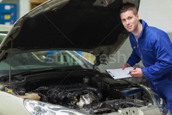Mechanic analyzing car engine Stock photo © wavebreak_media