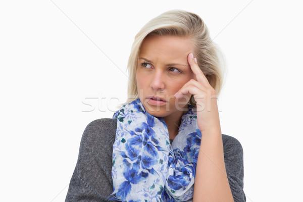 Worried blonde looking away Stock photo © wavebreak_media