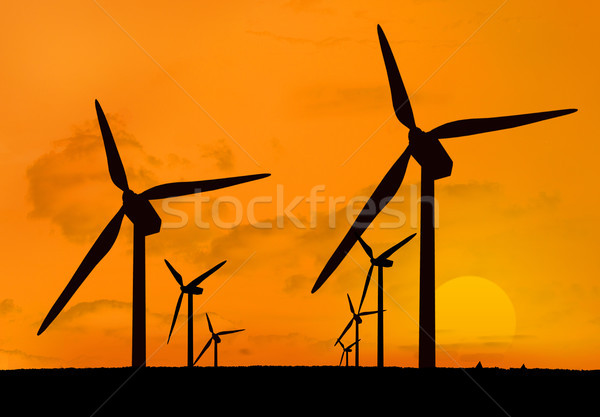 Wind turbines with a sunset in two lines Stock photo © wavebreak_media