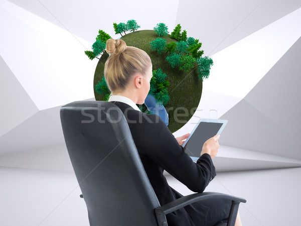 Composite image of businesswoman sitting on swivel chair with ta Stock photo © wavebreak_media