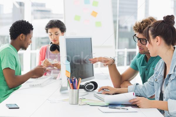 Artists working at desk in creative office Stock photo © wavebreak_media