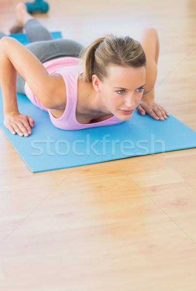 Determined beautiful woman doing push ups Stock photo © wavebreak_media