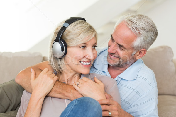 Mature man embracing woman from behind on sofa Stock photo © wavebreak_media