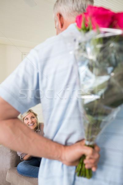 Férfi tart virágcsokor mögött hát nő Stock fotó © wavebreak_media