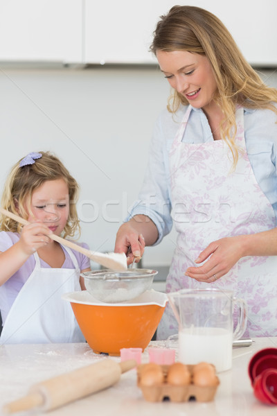Mother teaching daughter to make cookies Stock photo © wavebreak_media