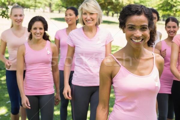 Women participating in breast cancer awareness at park Stock photo © wavebreak_media