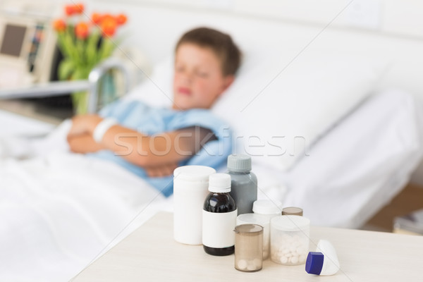 Medicines on table with boy in bed Stock photo © wavebreak_media