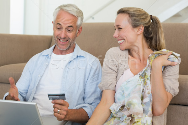 Happy couple shopping online on the couch Stock photo © wavebreak_media