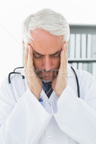 Close-up of a doctor with severe headache Stock photo © wavebreak_media