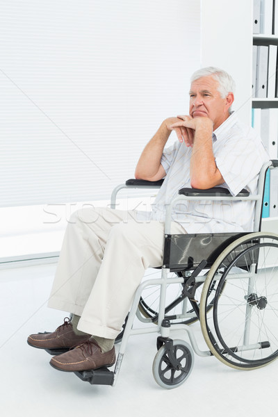 Side view of a sad senior man sitting in wheelchair Stock photo © wavebreak_media