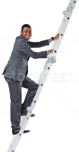Businessman climbing up ladder Stock photo © wavebreak_media