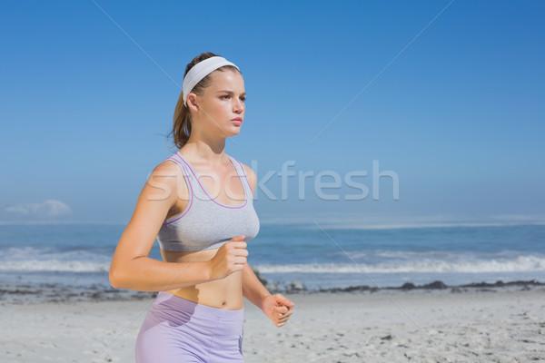 スポーティー ブロンド ジョギング ビーチ ストックフォト © wavebreak_media