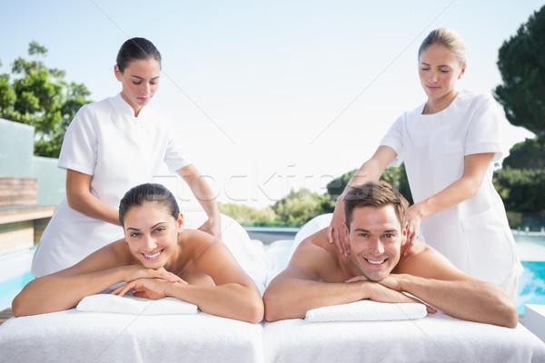 Smiling couple enjoying couples massage poolside Stock photo © wavebreak_media
