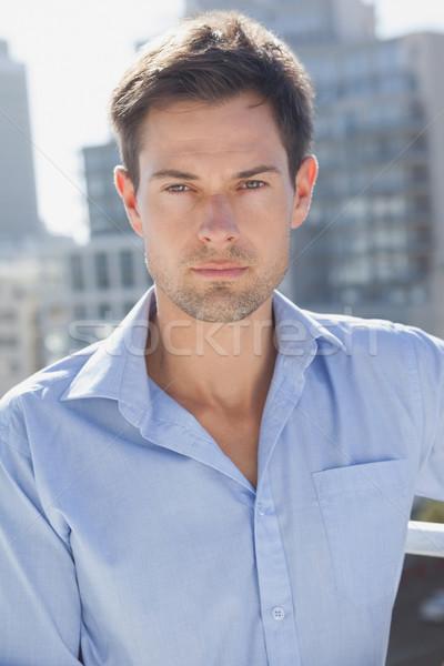 Jóképű férfi kamera erkély napos idő ház férfi Stock fotó © wavebreak_media