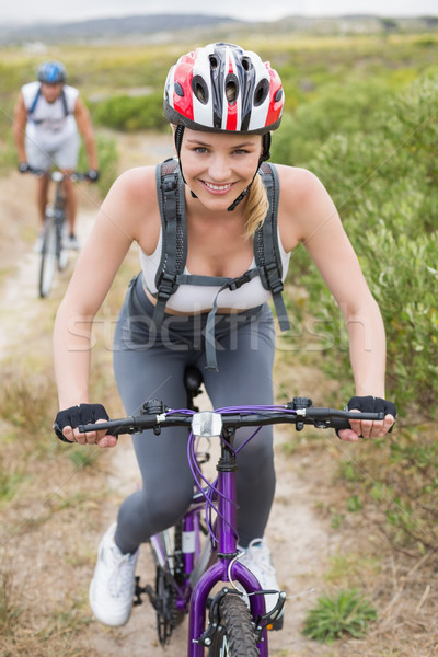 Fitt pár biciklizik hegy nyom napos idő Stock fotó © wavebreak_media