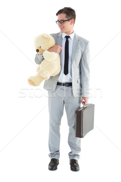 Yakışıklı işadamı evrak çantası oyuncak beyaz Stok fotoğraf © wavebreak_media