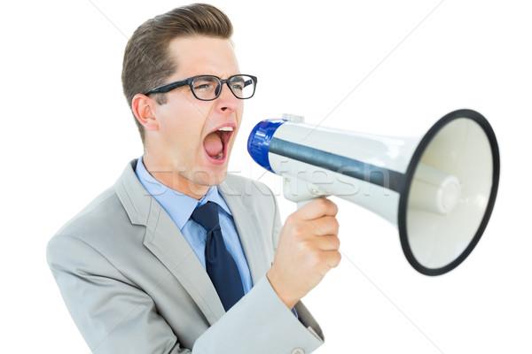 Geeky businessman shouting through megaphone Stock photo © wavebreak_media