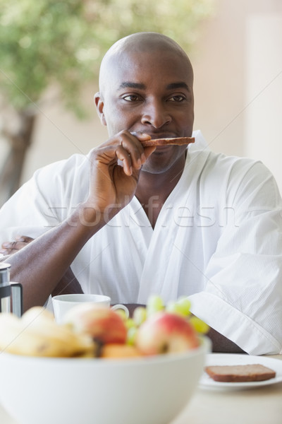 Gelukkig man badjas ontbijt terras Stockfoto © wavebreak_media