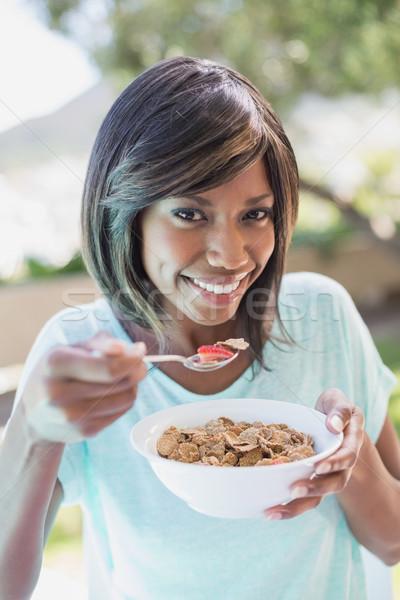 Pretty woman śniadanie na zewnątrz domu ogród Zdjęcia stock © wavebreak_media