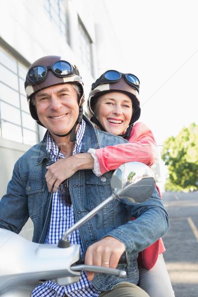 Happy senior couple riding a moped  Stock photo © wavebreak_media