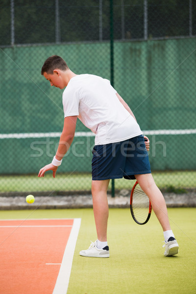Young tennis player about to serve Stock photo © wavebreak_media
