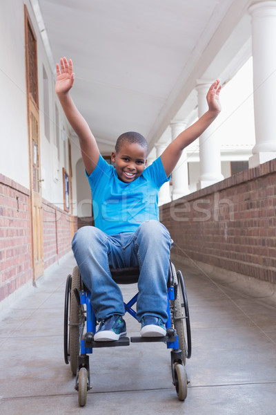Cute disabled pupil smiling at camera in hall Stock photo © wavebreak_media