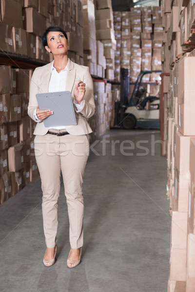 Warehouse manager checking her inventory Stock photo © wavebreak_media