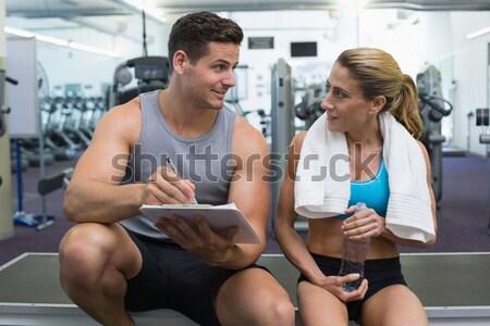 Geschikt vrouw tredmolen praten personal trainer gymnasium Stockfoto © wavebreak_media