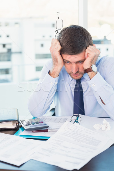 Stock photo: Stressed businessman with head in hands