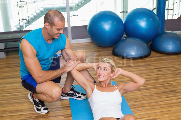 Entraîneur femme abdominale fitness Homme jeune femme Photo stock © wavebreak_media