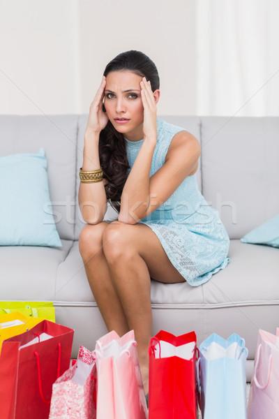 Regretful brunette with many shopping bags Stock photo © wavebreak_media
