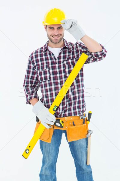 Confident handyman holding spirit level Stock photo © wavebreak_media